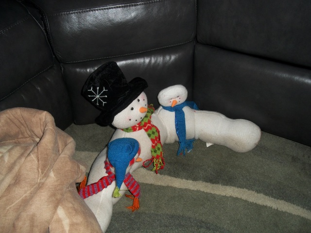He buried the snowman under the comforter, note there is no hat on the snowman on the right.